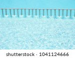 beautiful swimming pool at the... | Shutterstock . vector #1041124666