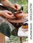 potter wheel handicraft   Shutterstock . vector #1041124750