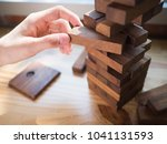 hand of man planning  risk and... | Shutterstock . vector #1041131593