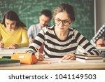 students in examination solving ...   Shutterstock . vector #1041149503