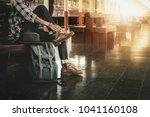 young man sitting tie his shoes ... | Shutterstock . vector #1041160108