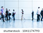 blurred people at a trade fair... | Shutterstock . vector #1041174793