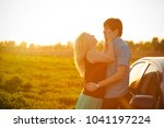 a loving couple watching...   Shutterstock . vector #1041197224