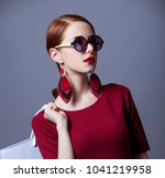 redhead woman i red dress with... | Shutterstock . vector #1041219958