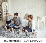 happy family playing with a pet ... | Shutterstock . vector #1041249229