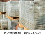 packaged paving slab on the... | Shutterstock . vector #1041257104