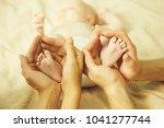small feet of newborn toddler...   Shutterstock . vector #1041277744