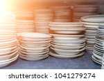 A Bunch Of Old Dishes On The...