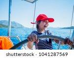 cute boy captain on board of...   Shutterstock . vector #1041287569