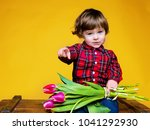 child with flowers on yellow... | Shutterstock . vector #1041292930