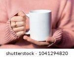 beautiful woman holding a warm...   Shutterstock . vector #1041294820