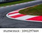 curving asphalt red and white... | Shutterstock . vector #1041297664