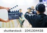 man hands holding movie clapper....   Shutterstock . vector #1041304438