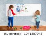 two cute little children... | Shutterstock . vector #1041307048