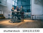 shot of a group of coworkers... | Shutterstock . vector #1041311530