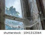 cobweb on old window abandoned... | Shutterstock . vector #1041312064