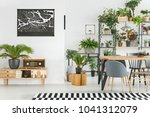 black map on white wall above a ... | Shutterstock . vector #1041312079