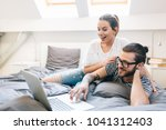 young couple watching a movie... | Shutterstock . vector #1041312403