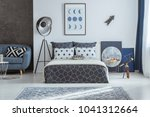 patterned pillow on blue couch... | Shutterstock . vector #1041312664