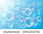 bubbles soap on blue background.... | Shutterstock .eps vector #1041316750