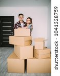 happy young couple moved to new ... | Shutterstock . vector #1041328759