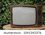 retro style tv in wooden table | Shutterstock . vector #1041342376