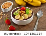 frozen acai bowl with fruits on ... | Shutterstock . vector #1041361114