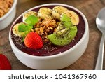 frozen acai berry bowl with... | Shutterstock . vector #1041367960
