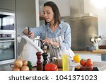 woman using kitchen robot to... | Shutterstock . vector #1041371023