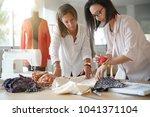 women designers in workshop... | Shutterstock . vector #1041371104