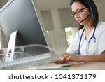 medical secretary typing report ... | Shutterstock . vector #1041371179