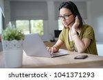 teleoperator working in office... | Shutterstock . vector #1041371293