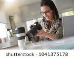 young woman photographer...   Shutterstock . vector #1041375178