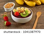 acai berry bowl with sliced... | Shutterstock . vector #1041387970