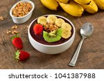 acai berry bowl with sliced... | Shutterstock . vector #1041387988
