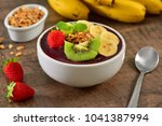 acai berry bowl with sliced... | Shutterstock . vector #1041387994