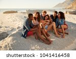 group of friends relaxing on... | Shutterstock . vector #1041416458