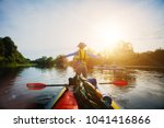 happy boy kayaking on the river.... | Shutterstock . vector #1041416866