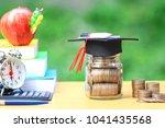 graduation hat on the glass... | Shutterstock . vector #1041435568