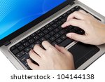 Closeup of hands typing on ultrabook laptop computer - stock photo
