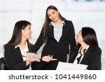 group of businesswomen working... | Shutterstock . vector #1041449860