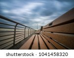 Dramatic Sky Over Benches On A...