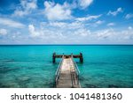 rusty dock at bermuda beach | Shutterstock . vector #1041481360