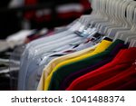 colorful t shirts on hang for...   Shutterstock . vector #1041488374