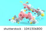pink gamepad and skateboard... | Shutterstock . vector #1041506800