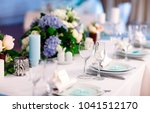 wedding table settings. | Shutterstock . vector #1041512170