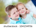brother and sister embracing... | Shutterstock . vector #104154956