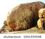 Small photo of Giant round granite boulder,two stacked rocks and tree in abscission in Ga-Masemola,Limpopo,South Africa
