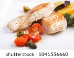 cod fillets with olives and... | Shutterstock . vector #1041556660