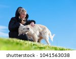 woman and dogs portrait playing ... | Shutterstock . vector #1041563038